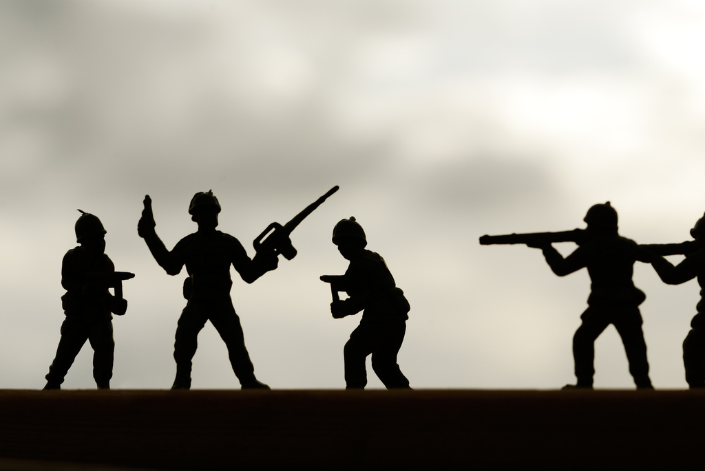 Toy soldiers in shadow