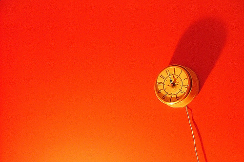 Clock on a red-orange wall