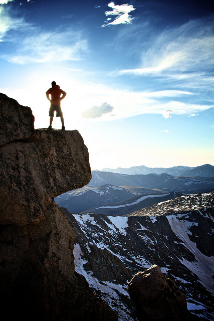 Hiker overlooking a Rocky Mountain vista