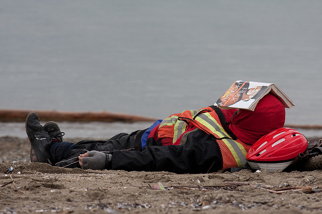 a person on a beach getting some serious rest